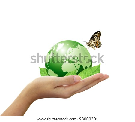 Green world and leaf have butterfly in woman hand