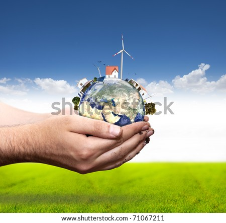 Green world concept with windmill and solar panel. More in my portfolio