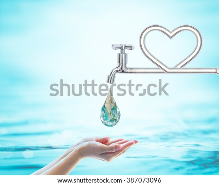 Green world droplet fall on woman human hand from heart love shape pipe water tap faucet on blur blue sea ocean day background: Saving aqua conceptual csr idea: Element of this image furnished by NASA