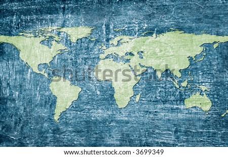 Green world map on blue grunge background