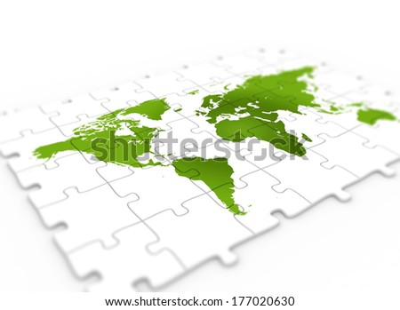 Green world map on puzzle piece