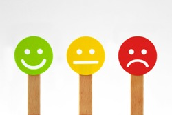 Green, yellow and red faces with positive, neutral and negative expression