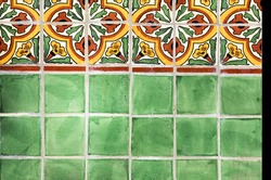 Green, yellow and red Mexican tile work on a fountain wall at the San Diego Botanical Gardens in California