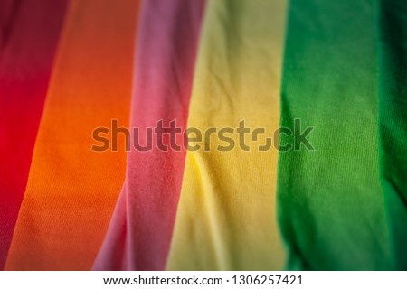 green yellow pink orange and red tee shirts. colorful of 100 percent cotton tee shirts in tee shirt factory