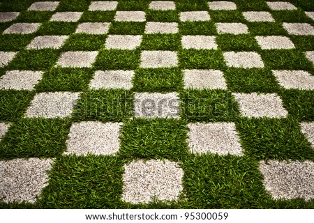 Green Zen garden. Chequered Grass. Background photo.