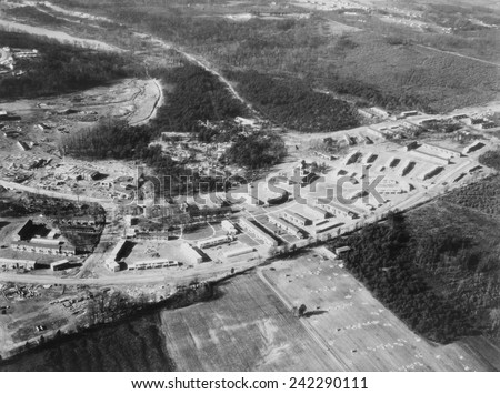 Greenbelt, Maryland, first model community planned by New Deal\'s programs authorized by the Federal Emergency Relief Act, signed on May 12. 1933, Photo of the completed housing taken in March 1937.