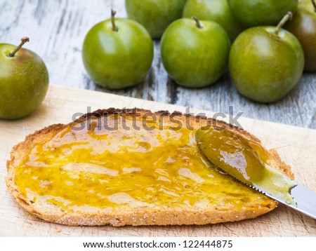 Greengage jam breakfast with slice of bread and fruit