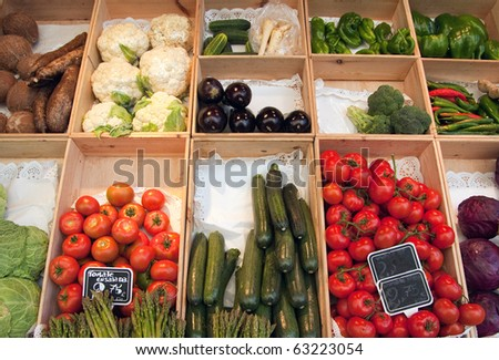 Greengrocer?s display with boxes full of fresh fruit and vegetables
