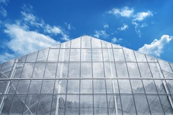 Greenhouse Against reflective light  Blue Sky
