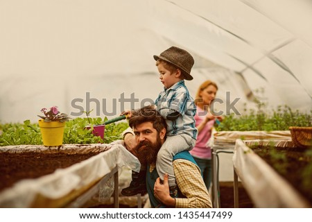 greenhouse hobby. greenhouse hobby of happy family. people have hobby in greenhouse. greenhouse hobby concept. flower expert