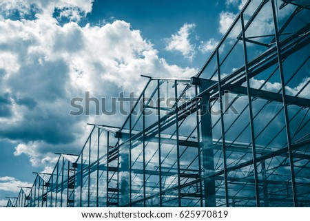Greenhouses against the blue sky #625970819