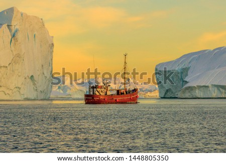 Greenland, Disko Bay. Tourists take pictures of the iceberg. Source of icebergs is by the Jakobshavn glacier. This is a consequence of the phenomenon of global warming and catastrophic thawing of ice #1448805350