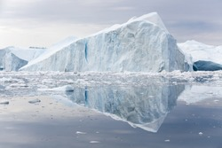 Greenland. The biggest glacier on a planet Jakobshavn. Huge icebergs of different forms in the gulf. Studying of a phenomenon of global warming and catastrophic thawing of ices.