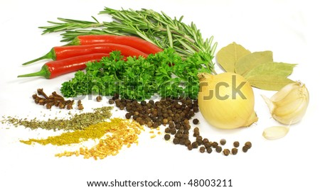 greens and spices isolated on white background