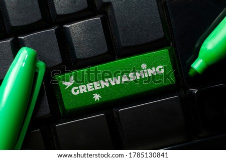 Greenwashing concept: a black keyboard with a green marker and the text greenwashing. Greenwashing is a communication technique to build a false image of a company in terms of environmental impact. Photo stock ©