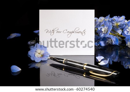 Greeting card and blue flowers