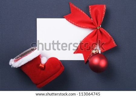 greeting card and christmas red decoration over grey background
