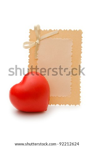 Greeting card and heart on the white background