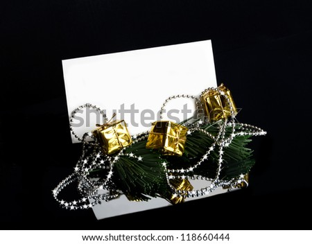 greeting card Christmas beads on the branch of a tree