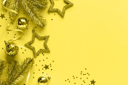 Greeting card concept voor Christmas New Year Festive Shining  composition color year 2021 illuminating toning.Trendy color of the year.Gold effect sparkle texture traditional decoration for the holi