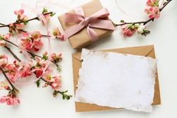 greeting card design. gift box with bow and pink azalea flowers on a white background. congratulation. invitation
