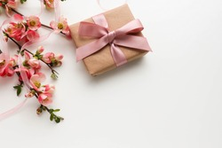 greeting card design. gift concept. gift box, flowers and an envelope on a white background. invitation. congratulation