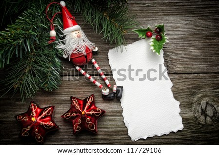 Greeting card for Christmas with Santa Claus decoration and candles