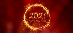 Greeting card Happy New Year 2021. Beautiful Wide Angle holiday web banner or billboard with Golden sparkling text Happy New Year 2021 written sparklers on festive red background.