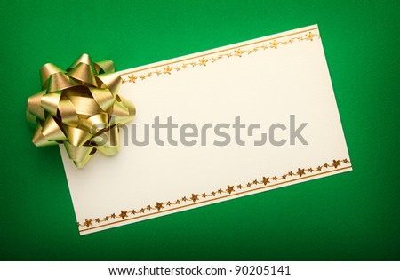 Greeting card on green paper with gold bow