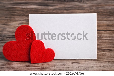 greeting card with a red hearts and space for text on a wooden background