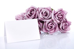 Greeting card with purple flowers on a white background, place for text