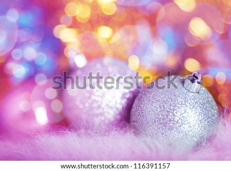 Greeting card with silver Christmas balls on colorful background