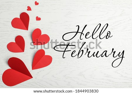 Greeting card with text Hello February. Red paper hearts on white wooden background, flat lay Stock photo ©
