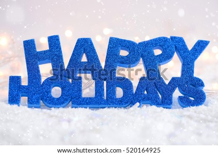 "Greeting ""Happy Holidays"" is on snow on a festive background #520164925"