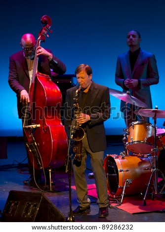 GRENADA, SPAIN - NOVEMBER 20: McCoy Tyner Trio at the XXXII International Jazz Festival on November 20, 2011 in Grenada, Spain - stock photo