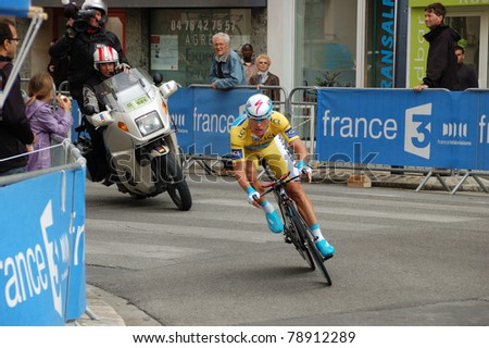 """GRENOBLE, FRANCE - JUN 8: Professional racing cyclist Alexandre Vinokourov rides UCI WORLD TOUR """" CRITERIUM DU DAUPHINE LIBERE"""" third stage time trial on June 8, 2011 in Grenoble city, Isere, France."""