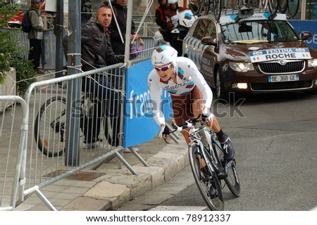 """GRENOBLE, FRANCE - JUN 8: Professional racing cyclist Nicolas Roche rides UCI WORLD TOUR """" CRITERIUM DU DAUPHINE LIBERE"""" third stage time trial on June 8, 2011 in Grenoble city, Isere, France."""