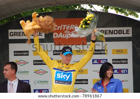 "GRENOBLE, FRANCE - JUNE 8: Professional racing cyclist Bradley Wiggins wears leader yellow jersey of UCI WORLD TOUR "" CRITERIUM DU DAUPHINE LIBERE"" time trial on June 8, 2011 in Grenoble, Isere France."