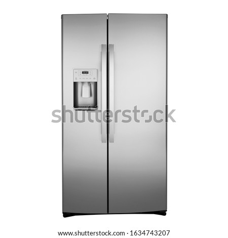Grey American Style Fridge Freezer Isolated on White. Side View of Stainless Steel Double Door Refrigerator. Full Frost Free Freezer. Modern Kitchen and Domestic Major Appliances