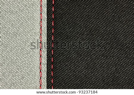 Grey and Black sewing textile with red thread. See my portfolio for more