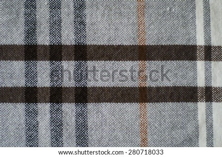 grey and brown  texture checkered knitted folded blanket