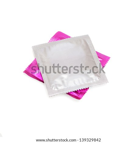 grey and pink condom on white background