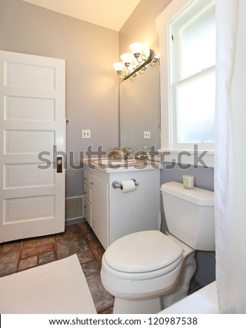 grey and white small bathroom with open door stock photo 120987538