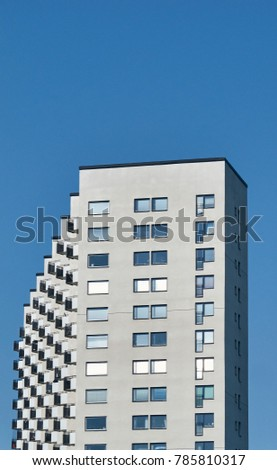 Grey apartment building view from Vasterbrom bridge in Stockholm with a blue sky #785810317