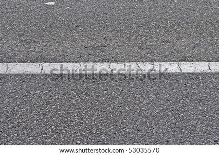 grey asphalt with white stripe