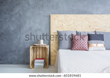 Grey bedroom with eco, diy bed and nighstand #601859681