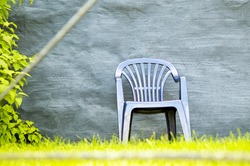 grey chair in the garden ,green grass ,plastic ,background ,leaves ,lovely ,trees ,nature ,relaxation ,decoration ,backyard ,nice ,outside