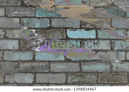 grey charcoal dirty stained brick wall with colourful poster paper and paint features #1398834467