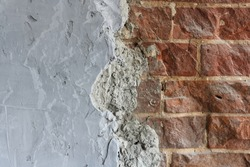Grey concrete surface with red brick masonry. Composite abstract background with space to copy. close-up