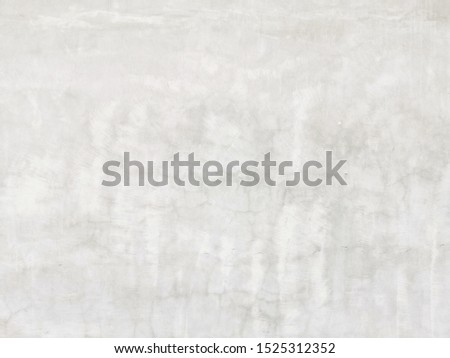 Grey concrete wall.White painted cement wall texture.Walls​ with​ a​ scratch is​ painted with​ cerulean oil​.Abstract painting art backgrounds. Hand-painted texture.